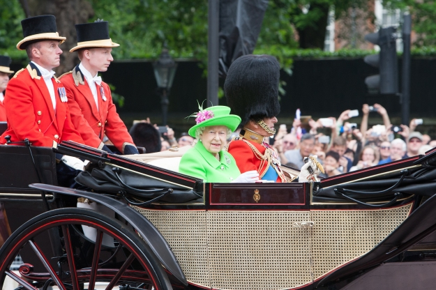 The Queen wearing a very striking neon outfit on the day